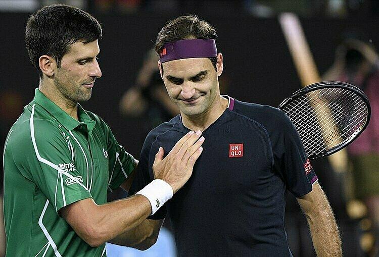Federer (phải) chưa từng thắng Djokovic tại Grand Slam kể từ năm 2012. Ảnh: AP.