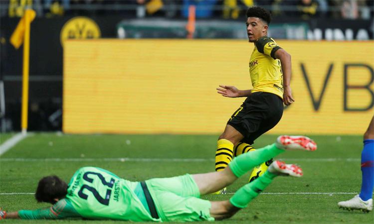 Sancho đang thăng hoatrên bệ phóng là chính sách trọng dụng, tin dùng các sao trẻ của Dortmund. Ảnh: Reuters.