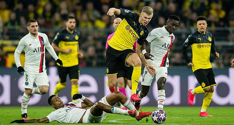 Haaland (vàng, tranh bóng) ghi 11 bàn chỉ sau bảy trận khoác áo Dortmund. Ảnh: UEFA.