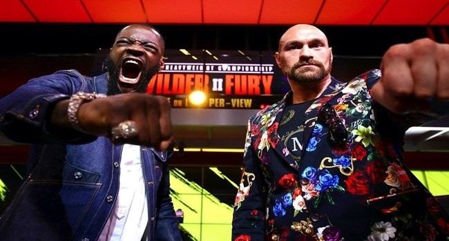 Fury (phải) và Wilder trong buổi chụp ảnh quảng bá cho trận tái đấu. Ảnh: The Rank.