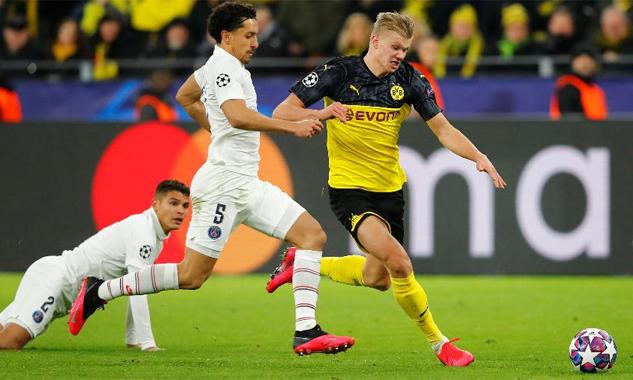 Haaland đánh bại hai trung vệ PSG - Thiago Silva và Marquinhos - trong tình huống ghi bàn cho Dortmund hôm 19/2. Ảnh: Reuters.