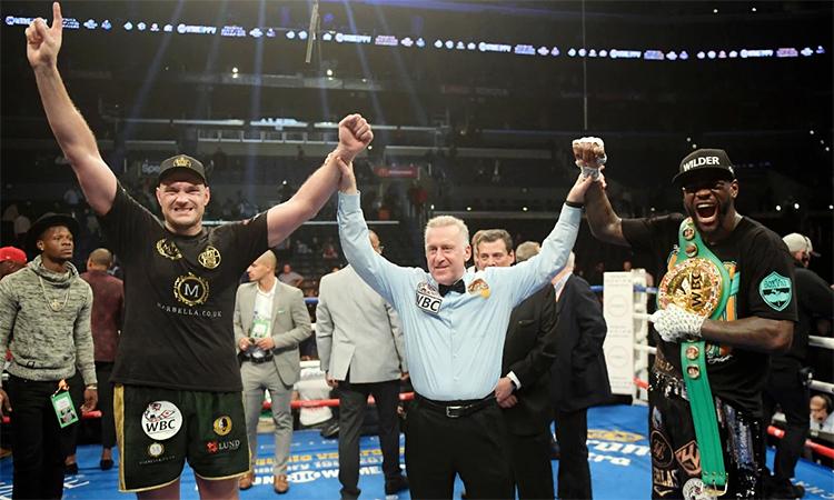 Fury (trái) và Wilder là hai trong số những võ sĩ quyền Anh hạng nặng giỏi nhất hiện nay. Ảnh: AP.