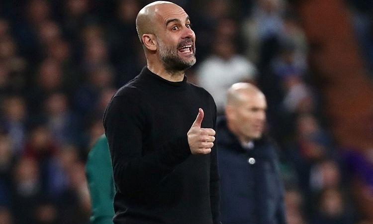 Guardiola ghi dấu ấn khi Man City thắng trên sân Real. Ảnh: Reuters.