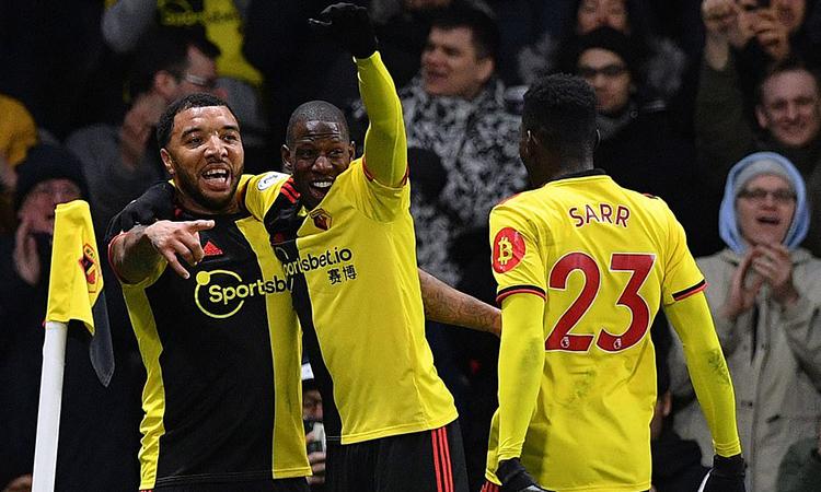 Deeney, Doucoure và Sarr - ba nhân vật chính giúp Watford thắng Liverpool. Ảnh: AFP.