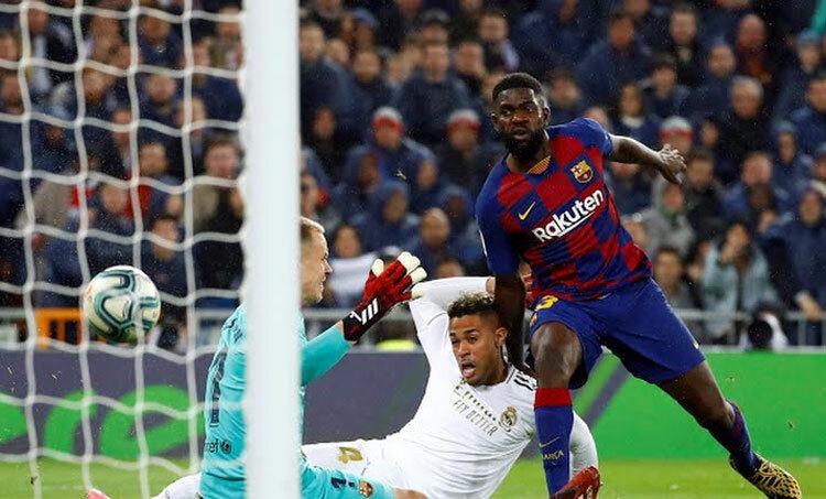 Barca để thua 0-2 trong trận El Clasico. Ảnh: Reuters.
