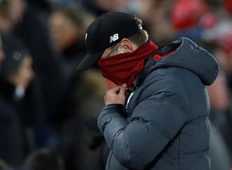 Mùa giải đang diễn ra theo chiều hướng không thuận lợi cho HLV Klopp và các cầu thủ Liverpool. Ảnh: Reuters.