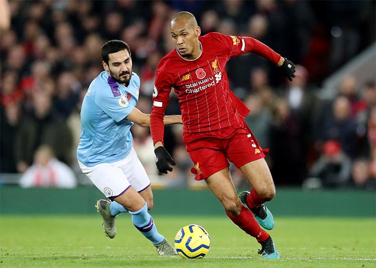 Gundogan (áo xanh) là thành viên Man City vô địch Ngoại hạng Anh hai mùa gần nhất, trước khi bị Liverpool bỏ xa ở mùa này. Ảnh: PA.