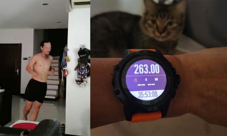Yim khoe đồng hồ ghi tổng quảng đường chạy và ảnh anh chạy siêu marathon trong nhà.