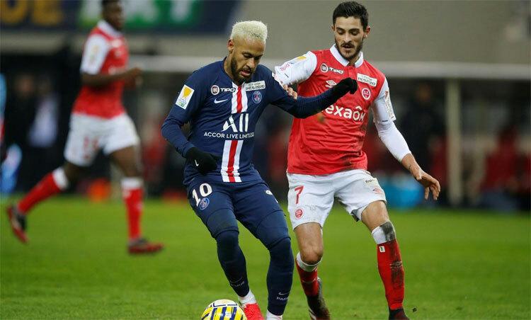 Reims (áo đỏ) đứng thứ năm Ligue 1 và vào bán kết Cup Liên đoàn mùa này. Ảnh: Reuters.