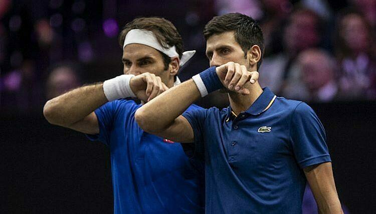 Federer (trái) hơn Djokovic ba Grand Slam. Ảnh: AFP.