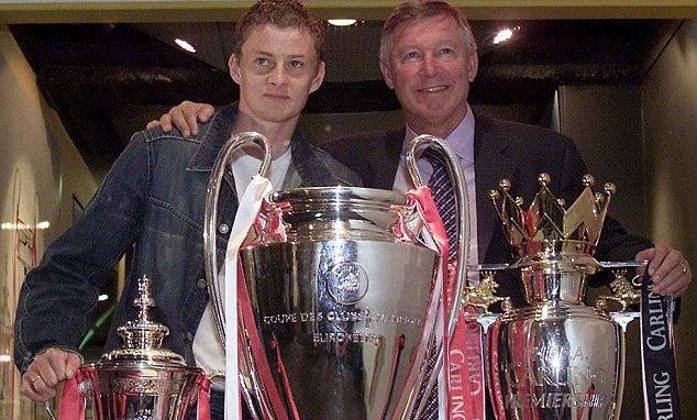 Ferguson và Solskjaer, cầu thủ ghi bàn quyết định vào lưới Bayern, cùng ba danh hiệu năm 1999. Ảnh: Reuters.