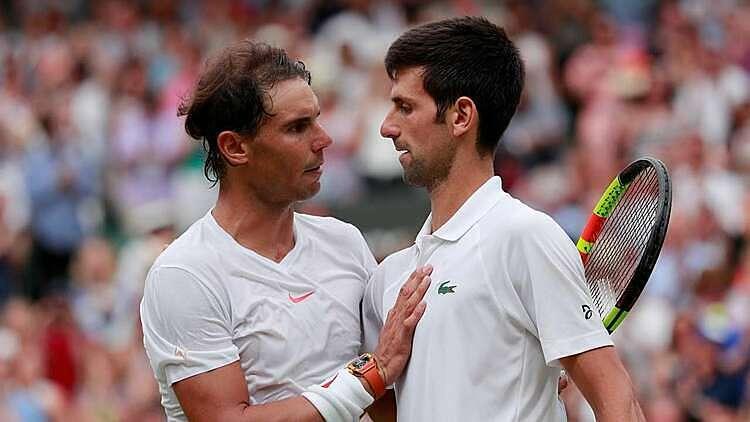 Djokovic (phải) và Nadal gặp nhau tổng cộng 55 trận. Ảnh: Reuters.