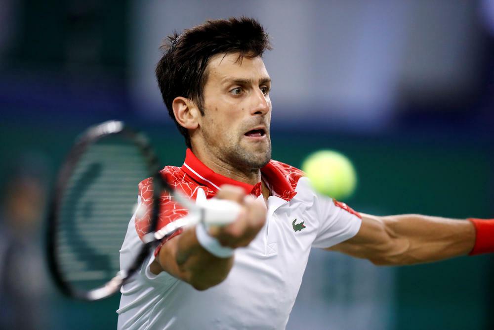 Trả giao là một trong những vũ khí thượng hạng của Djokovic. Ảnh: Reuters.