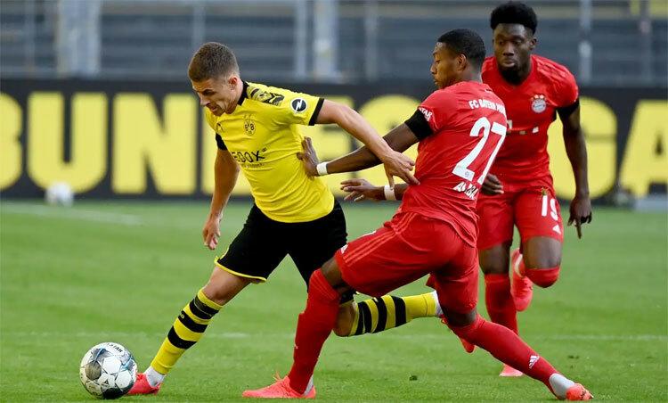 Bayern (áo đỏ) đang trên tầm nhiều đối thủ mạnh. Ảnh: Reuters.