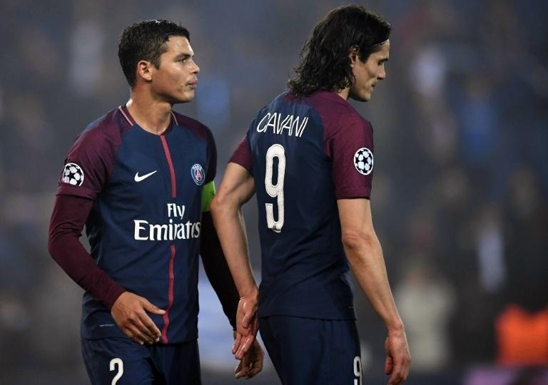 Thiago Silva (trái) và Cavani là hai công thần của PSG trong nhiều năm qua. Ảnh: AFP.