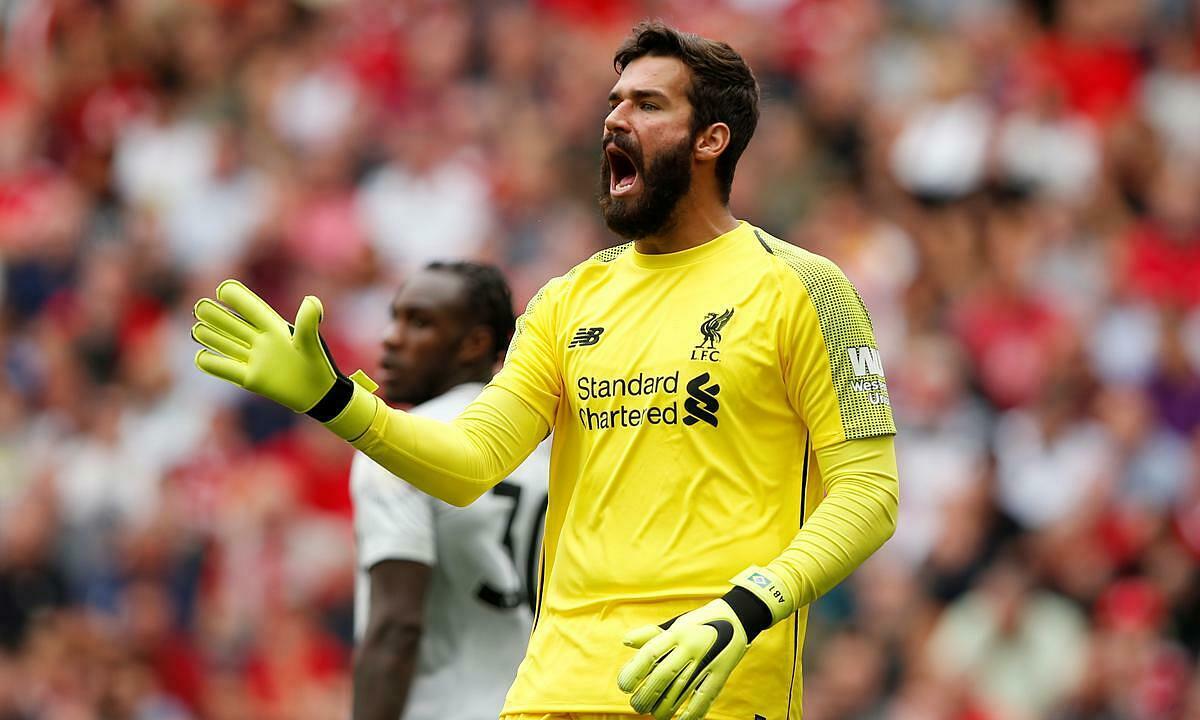 Alisson gia cố hàng thủ Liverpool. Ảnh: Reuters.