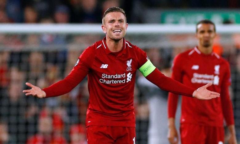 Henderson cùng đồng đội ở Liverpool chỉ còn cách chức vô địch Ngoại hạng Anh hai trận thắng. Ảnh: Reuters.