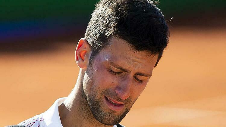 Djokovic là tay vợt thứ tư nhiễm nCoV trong ít ngày qua. Ảnh: PA.
