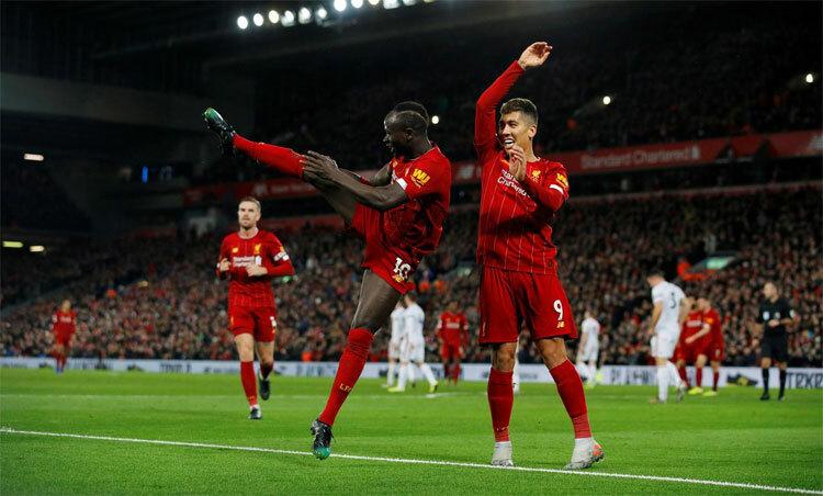 Liverpool làm nên trang sử mới cho bóng đá Anh. Ảnh: Reuters.