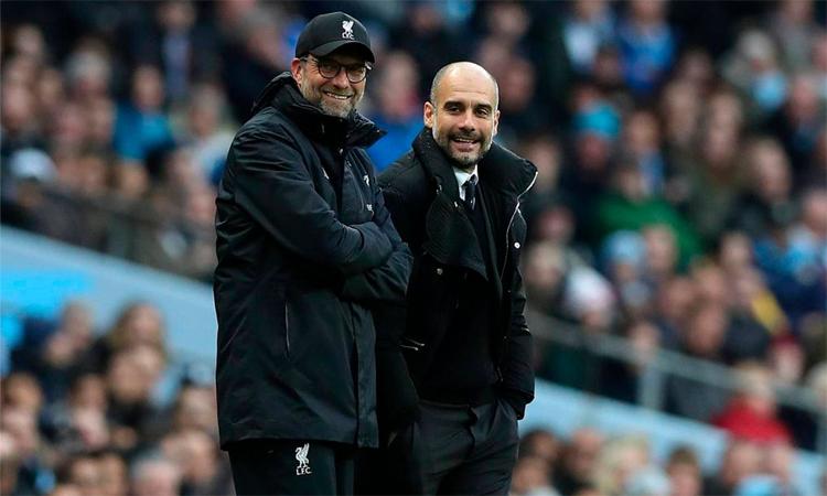 Guardiola ngưỡng mộ triết lý tấn công của Klopp. Ảnh: Reuters.