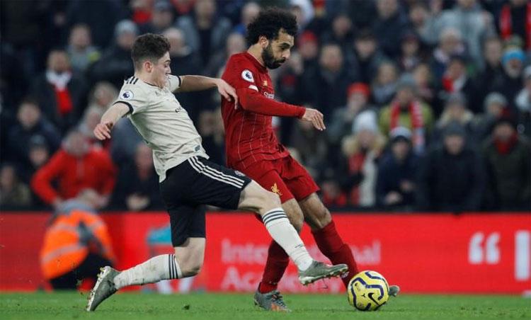 Man Utd sắp bị Liverpool qua mặt về giá trị. Ảnh: Reuters.