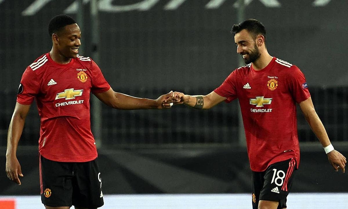 Martial và Fernandes đưa Man Utd vào bán kết. Ảnh: PA.