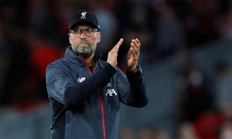 Klopp giành Ngoại hạng Anh mùa trước với 99 điểm, chỉ kém một điểm so với kỷ lục năm 2018 của Man City. Ảnh: Reuters.