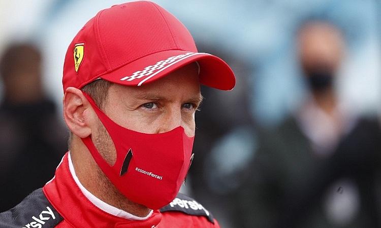 Vettel kêu gọi Ferrari tiếp tục lạc quan sau những kết quả tệ hại ở mùa này. Ảnh: AFP.