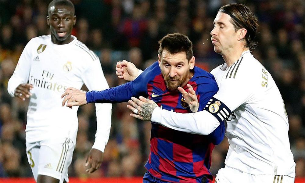 Ramos cố ngăn cản Messi đi bóng trong trận El Clasico mà Real thắng Barca 2-0 hôm 1/3. Ảnh: EFE