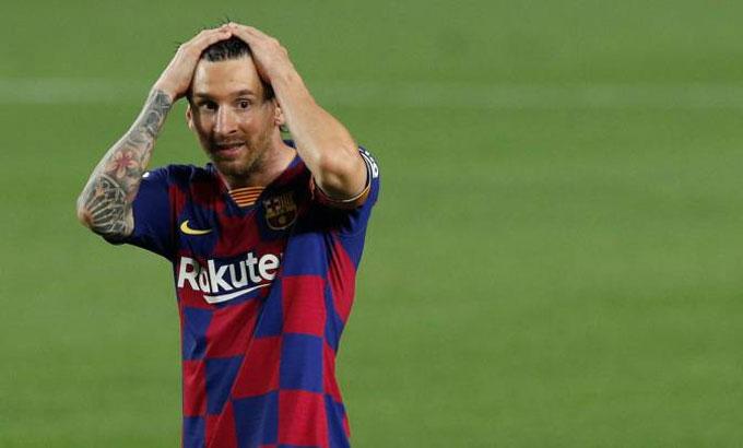 Messi quyết định ở lại do không thể trả 825 triệu USD phá hợp đồng. Ảnh: Reuters.
