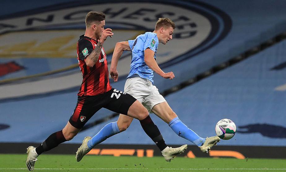 Delap (phải) có bàn thắng ngay trận đầu tiên cho Man City. Ảnh: PA.