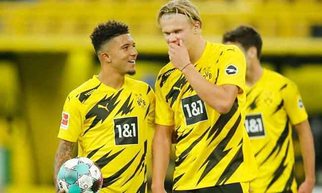 Dortmund sớm muộn cũng phải bán Sancho (trái) và Haaland. Ảnh: Reuters