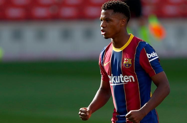 Fati lập hàng loạt kỷ lục từ khi khoác áo đội một Barca vào cuối năm 2019. Ảnh: AP.