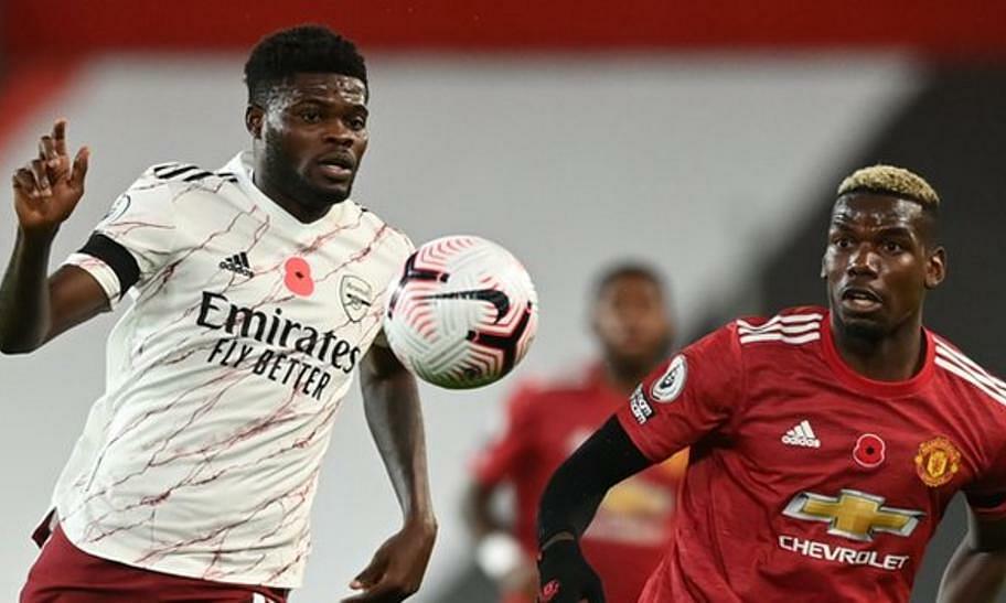 Partey (trái) chơi nổi bật trong hàng tiền vệ Arsenal, hóa giải hai ngòi nổ nguy hiểm của Man Utd là Pogba và Bruno Fernandes. Ảnh: Reuters.