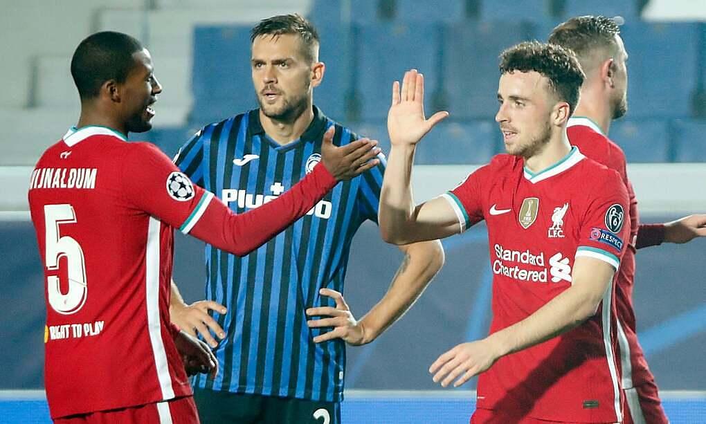 Jota (phải) ghi bàn trong bốn trận gần nhất. Ảnh: Reuters.