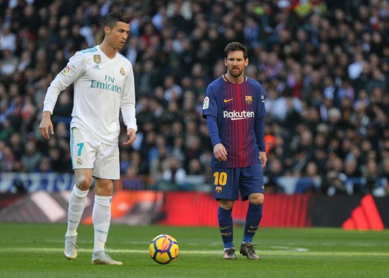 โรนัลโด้และเมสซี่เป็นเจ้าของลูกบอลทองคำทั้งหมด 11 ลูกในรอบ 12 ปี  ภาพ: Reuters
