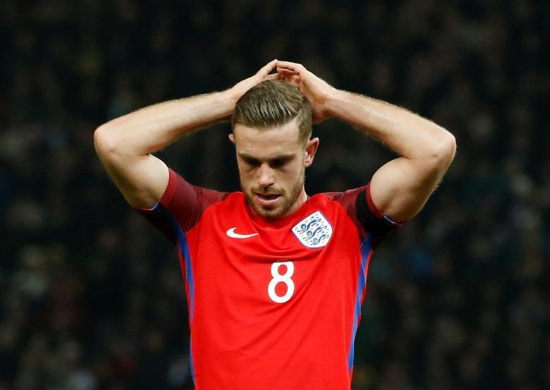 Henderson là thủ quân trong hành trình giành Champions League 2019 và Ngoại hạng Anh 2020 của Liverpool. Ảnh: Reuters.