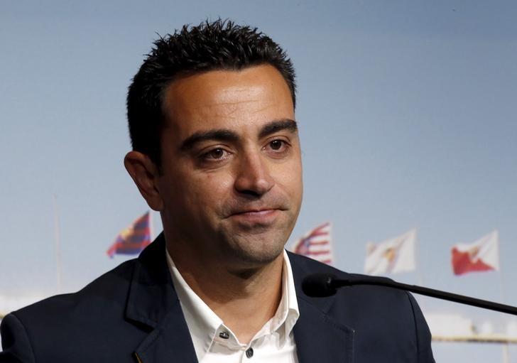 ซาวี่เล่นให้กับบาร์ซ่า 17 ปีรวมถึงตำแหน่งกองกลางชั้นนำหลายปีและสวมปลอกแขนกัปตันทีม  ภาพ: Reuters