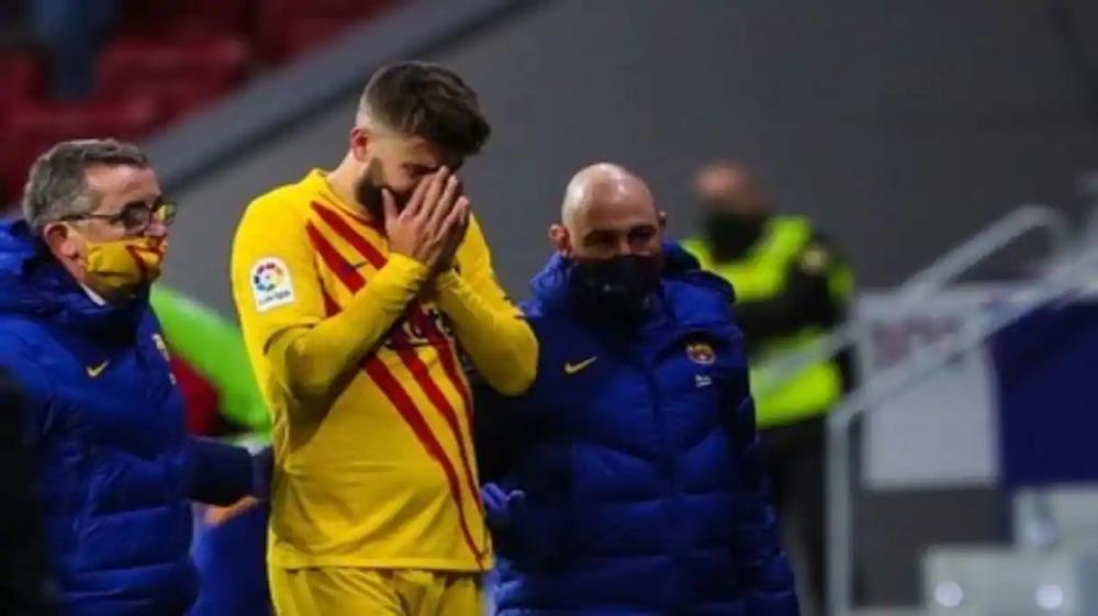Pique cần nhiều tháng để bình phục chấn thương đầu gối. Ảnh: Reuters.