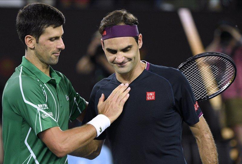 Novak Djokovic, Roger Federer cùng các tay vợt dự Australia Mở rộng 2021 có thể không được tập luyện trong 14 ngày cách ly ở Melbourne. Ảnh: AP.