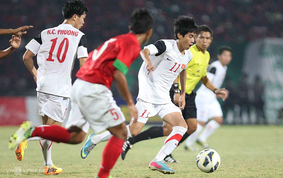 Phan Thanh Hau (19) ในเสื้อ U19 ของเวียดนามเคยบุกเอเชียตะวันออกเฉียงใต้ในปี 2013, 2014 ภาพ: Duc Dong