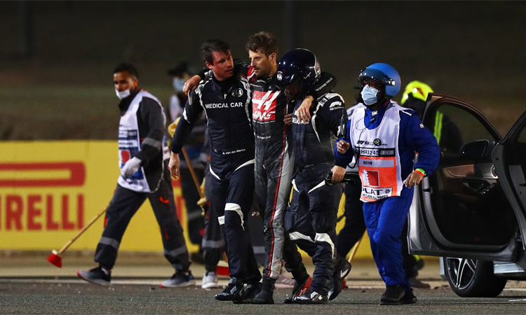 Grosjean was accompanied by medical staff from the scene of the accident.  Photo: Formula 1.