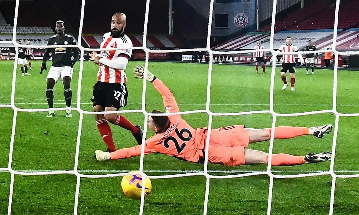 McGoldrick lập cú đúp vào lưới Man Utd. Ảnh: NMC Pool.