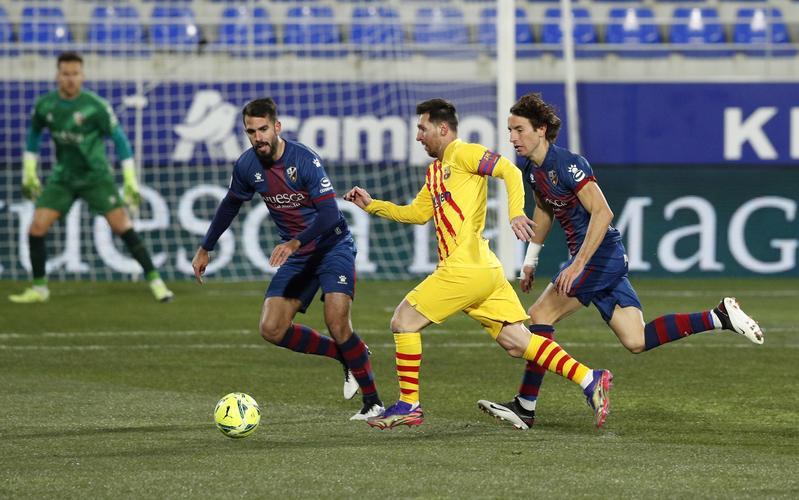 Messi membantu Barca meraih tiga poin dalam pertandingan ke-500 di La Liga.  Foto: Reuters.