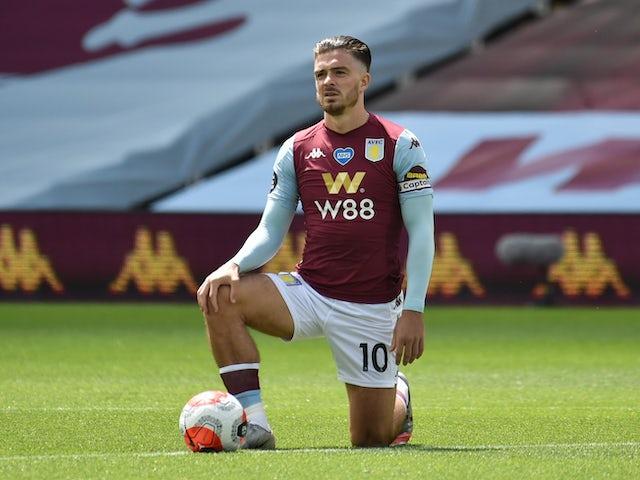 Jack Grealish และ Aston Villa ถูกแช่แข็งเหนือ Covid-19  ภาพ: Reuters
