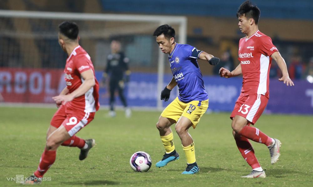Van Quyet และ Ha Noi ชนะการแข่งขันฟุตบอลเวียดนามในปี 2021 ภาพ: Lam Tho