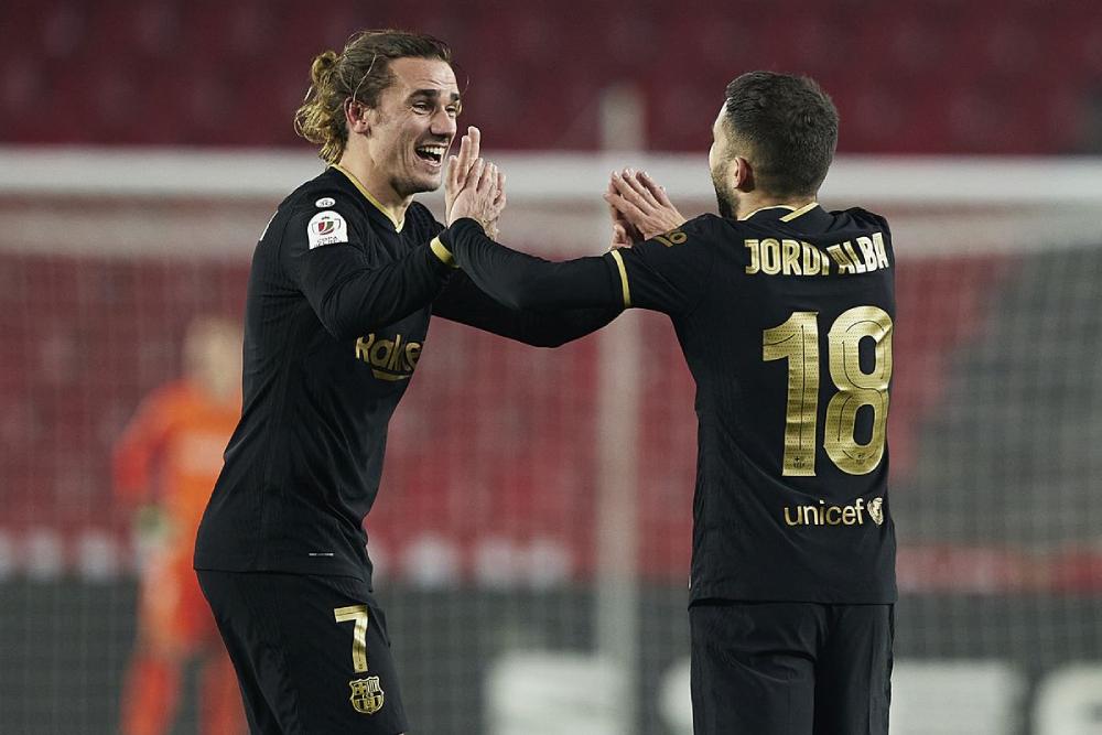 Griezmann mencetak dua gol dan membuat dua operan untuk membersihkan geladak untuk Alba.