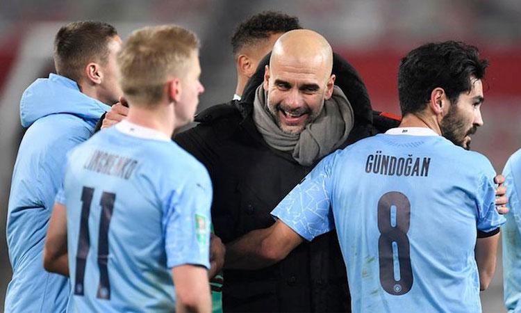 Guardiola và Man City tiếp tục chinh phục thêm một kỷ lục. Ảnh: AFP.