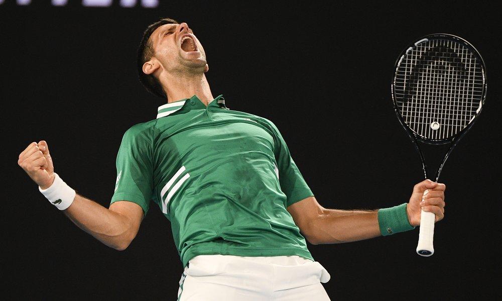 Djokovic mừng chiến thắng trước Fritz theo cách giải tỏa. Ảnh: AP.