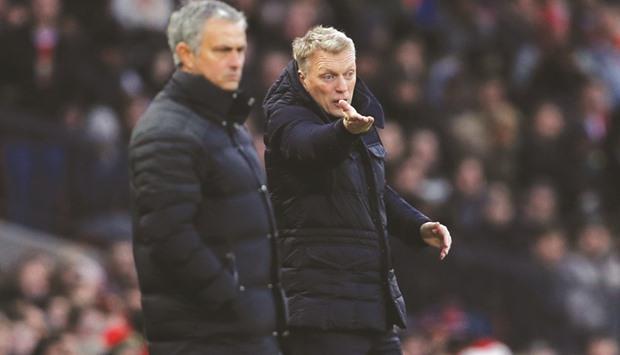Moyes chưa bao giờ thắng Mourinho. Ảnh: Reuters.